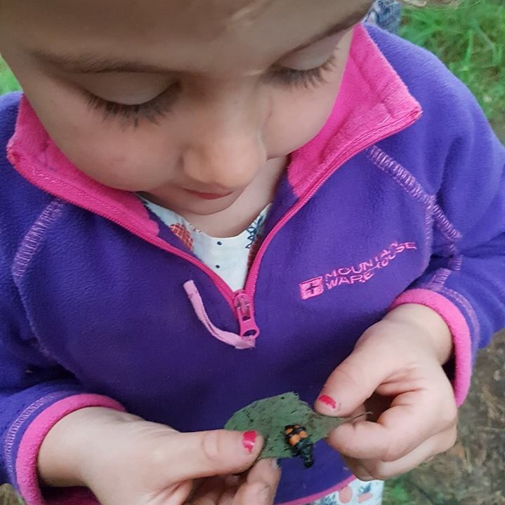 Caravanning and kids - holding a bug